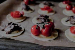 gruyère tarts with tomatoes and mushrooms before baking
