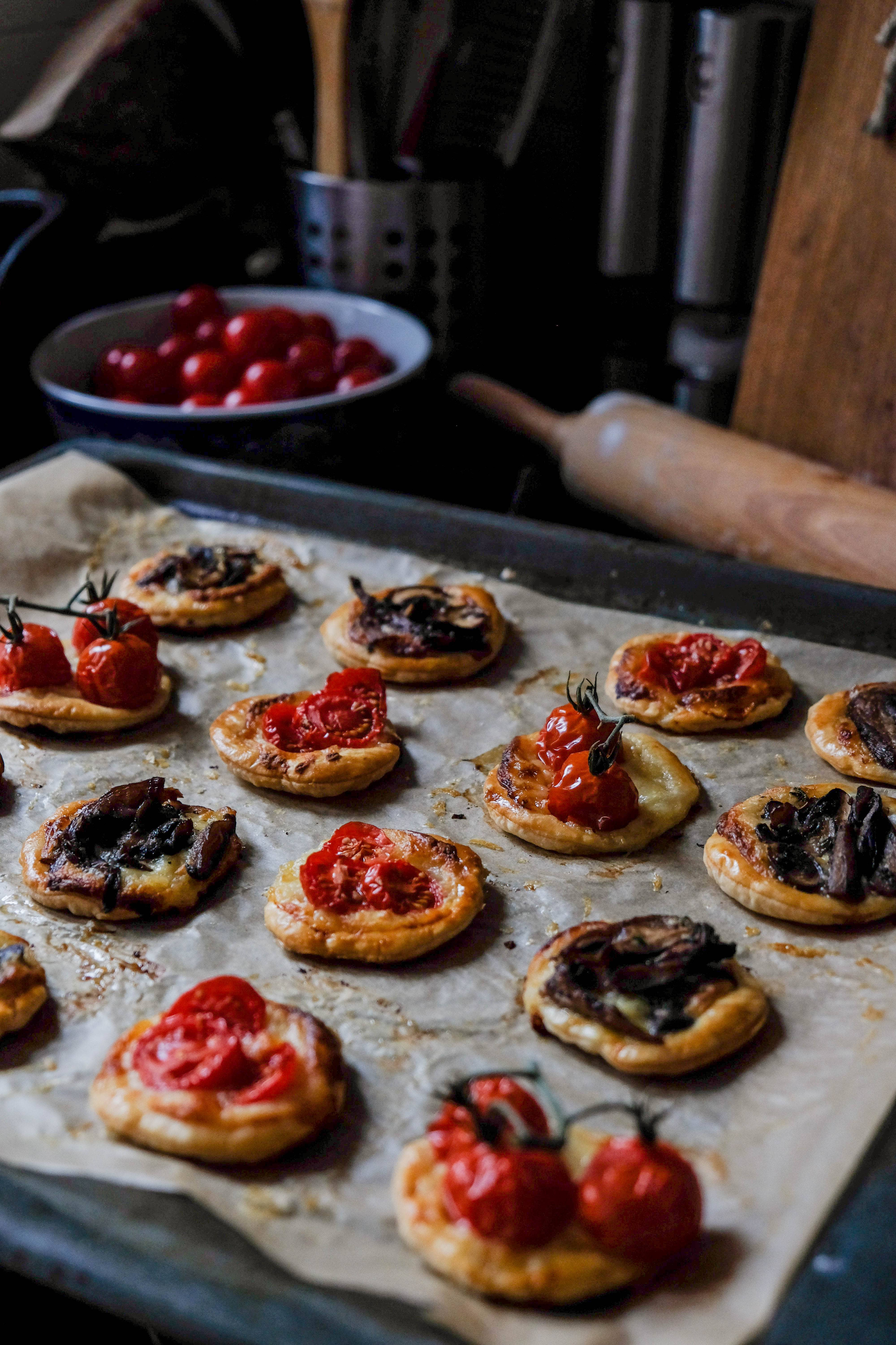 gruyère tarts with mushrooms and burst tomatoes