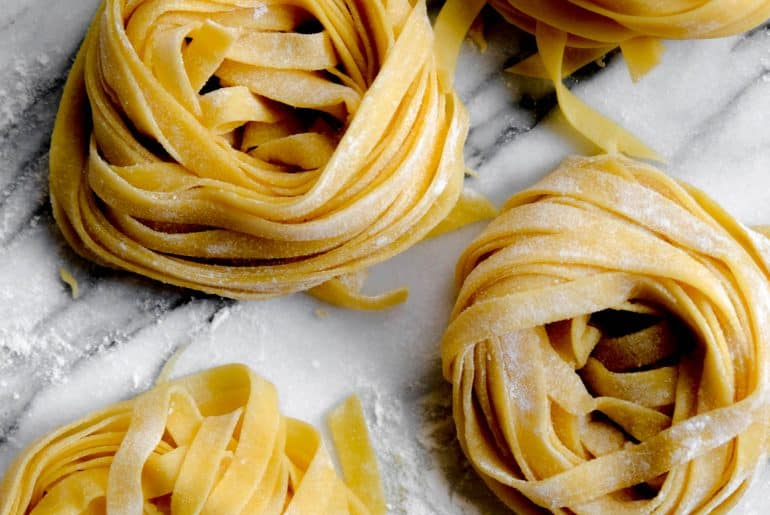Handmade fettuccini pasta bundles waiting to be cooked